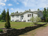 LARGE HOME WITH DEEDED ACCESS TO WATER ~ 27 Michel, Grande-Digue