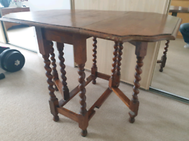 Antique dropleaf dining table