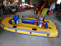 Challenger Inflatable Boat with 2 life jackets , 2 oars.