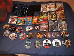 PS2 two controllers memory card and 30 games