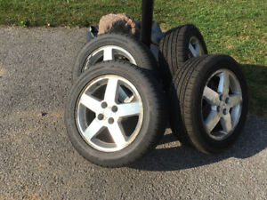 All season and winter tires for sale off a Pontiac Pursuit 2005