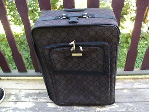 grosse valise Oscar de la Renta