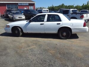 TWO Ford Crown Victoria ex cop cars