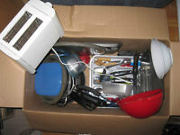Bunch of kitchen appliances, plates, stereo, PC screen and more