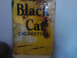 Metal black cat cigarette sign