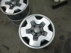 "Four 15"" factory aluminum wheels fits small Jimmy or Blazer"
