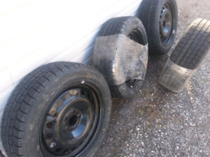 SNOW TIRES ON 5 X 110mm GM RIMS (NEW)