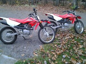 Two Honda CRF 100 Dirt Bikes