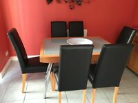 Extending kitchen table & 6 Faux leather chairs