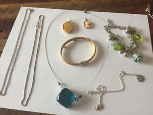 Assorted necklace chains and pendants, bracelets
