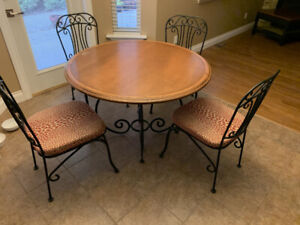 Rod iron and solid wood table with 5 matching chairs