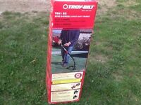 New in box--  TROY string GAS trimmer