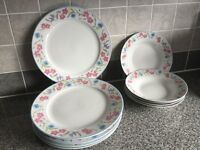 5 x fine China plates and 5 x matching dishes.