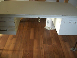 Steel desk with locked file cabinets