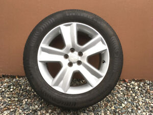 Subaru alloy rims with tires