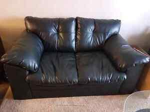 Black leather couch and matching love seat