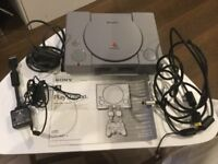 PlayStation one with two controllers, two memory cards and 10 games.