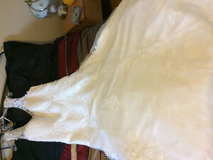 Never worn, size 18 flowing wedding gown