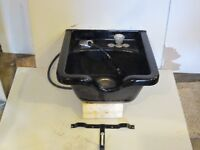 Shampoo sink with brackets and taps