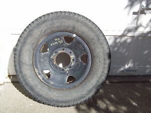 Ford Tire and Rim  - $150 offers?