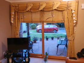Curtains /swags & tails plus blinds.