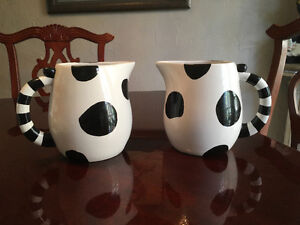 Two cow pitchers