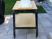 Metal tool table on casters