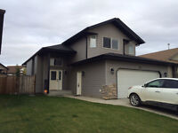 3 Bedroom 3 Bathroom Modified Bi-Level w/ Double attached Garage