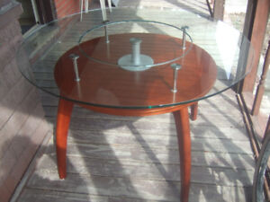 unique wood and glass table with lazy susan