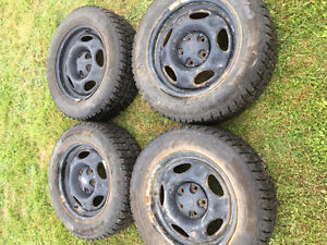 225 60 15 studded tires on rims- trade for hunting gear
