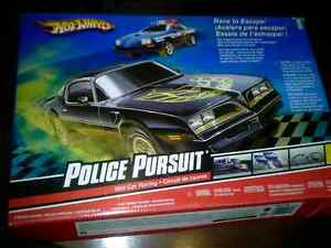 Hot Wheels Police Pursuit Slot Car Racing (Benefits SPCA)