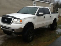 2006 Ford F-150 SuperCrew LARIAT Pickup Truck lifted