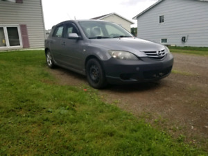 06 Mazda 3 hatch. 5 speed. MVI til Oct 31.
