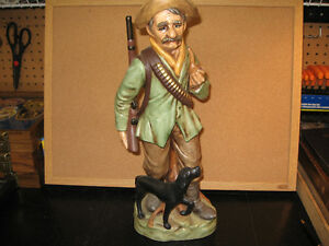 Ceramic figurine - Old hunter with his dog