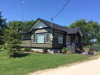 GORGEOUS TIMBER HOME in STE. ANNE, MB