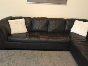 Genuine leather sectional with pull out bed