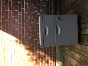 Small filing cabinet with lock and key