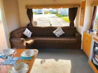 2 bed (sleeps 6) starter caravan for sale with 2018 fees already paid on coast
