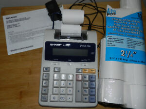 SHARP ADDING MACHINE, INSTRUCTION BOOK AND EXTRA ROLL OF TAPE