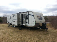 2014 Sport Trek 320 Quad bunks, Outdoor kitchen, Three slides