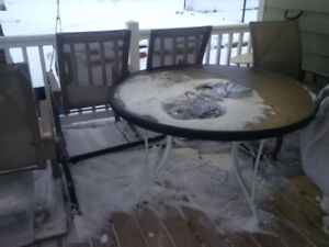 Glass patio table and four chairs - used but good condition