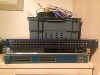 Server cabinet ethernet port banks and cables NETGEAR BAYSTACK CISCO