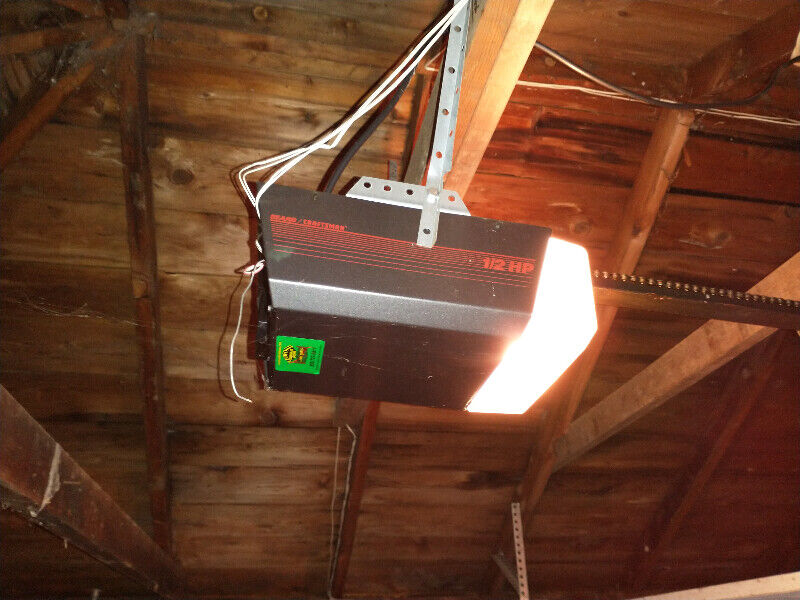 Garage door opener + remote + door + tracks
