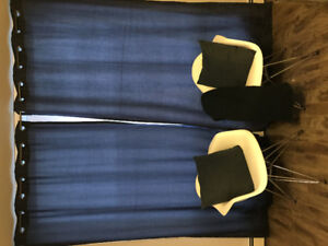 Navy blue curtains, matching pillows and throw