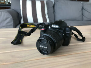 Nikon D3200 with 2 lenses (18-55mm and 55-200mm)
