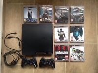 PlayStation 3 console, 2 controllers and 8 games
