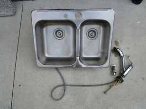 kitchen sink and faucet and soap dispenser