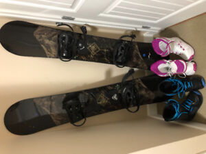 Two 160 cm snowboards with men's size 8 boots and ladies size 9