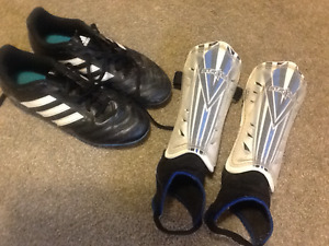 Youth size 5 soccer cleats & shin guards