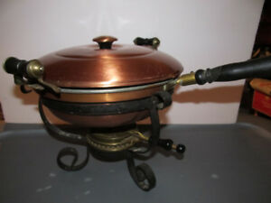 Antique chaffing dish made of copper.